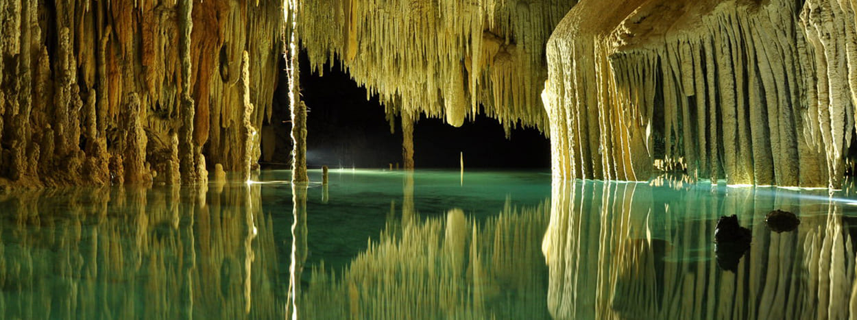 https://www.karmatrails.com/web/uploads/2020/04/Rio-Secreto-cenote.jpg